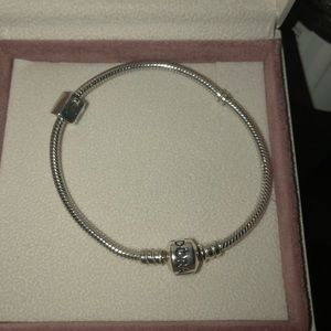 Silver Pandora bracelet with retired house charm